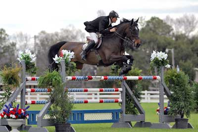 Bill Lowry jumping a Grand Prix